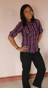 Lisa flaunting her new plaid shirt, mid-laugh as she couldn't take the photo-shoot seriously.