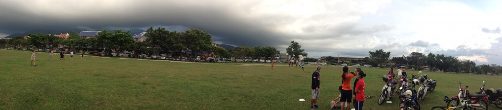 Rain clouds, motorbikes and x-cross ultimate players in Kampar, Malaysia