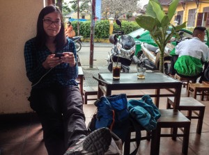 drinking iced coffee at google cafe on a day in Hoi An when locals were bundled up in jackets.