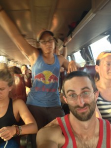 """Unimpressed travelers nearing the end of a 24 hour bus """"adventure"""" -- without seats."""